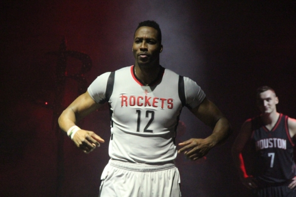 image: Dwight Howard flexes and models the Houston Rockets' new home alternate jersey. Photo courtesy of @00rocketgirl on Twitter.