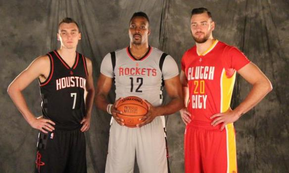image: From L-R: Sam Dekker, Dwight Howard and Donatas Motiejunas pose for a picture as they model the new Rockets alternate jerseys. Photo courtesy of rockets.com