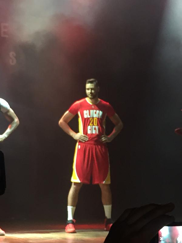 "image  Donatas Motiejunas stands and models the Houston Rockets  alternate  pride ""CLUTCH CITY f95b129f1"