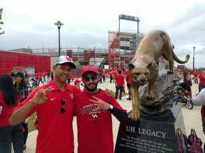 PHOTO: Raj Sheth, The Signal Assistant Editor, and Joshua Pulumbarit, _____, next to UH Legacy statue of Shasta the UH mascot at Photo taken at at UH vs. Navy game at TDECU Stadium. Photo courtesy of Raj Sheth, The Signal Assistant Editor.