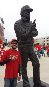 PHOTO: Raj Sheth, The Signal Assistant Editor, with statue of Bill Yeoman. Photo by Joshua Pulumbarit, Lab Technician at Marathon Petroleum Corporation.